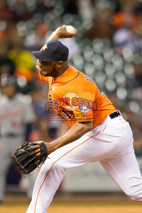 Houston Astros pitcher Jose Veras (41) delivers a pitch to the plate during the MLB baseball game against the Detroit Tigers on May 3, 2013 at Minute Maid Park in Houston, Texas. Detroit defeated Houston 4-3. (Andrew Woolley/Four Seam Images).