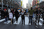 Protesters calling on Chicago Mayor Rahm Emanuel to resign march up State Street in the Loop in Chicago, Illinois on December 9, 2015.  Emanuel offered a historic apology for the police killing of Laquan McDonald and police brutality and racial profiling generally -- without using those words -- in front of the City Council in the morning.