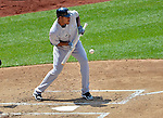 17 June 2012: New York Yankees starting pitcher Ivan Nova lays down a sacrifice bunt against the Washington Nationals at Nationals Park in Washington, DC. The Yankees defeated the Nationals 4-1 to sweep their 3-game series. Mandatory Credit: Ed Wolfstein Photo