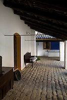 A seat under a wooden roof looks out onto one of the courtyards of the Hacienda Benazuza, Sanlucar La Mayor, Spain