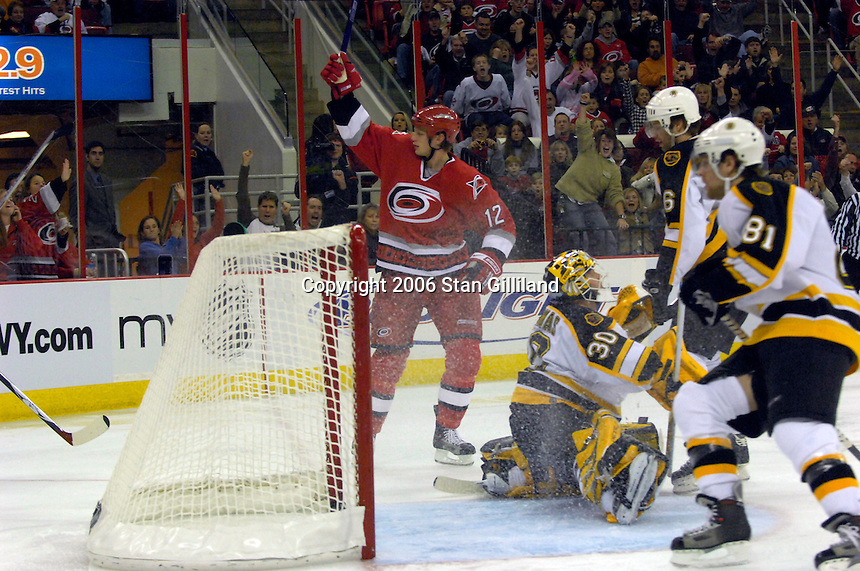 The Carolina Hurricanes' Eric Staal (12) celebrates a third period goal against the Boston Bruins during an NHL hockey game Saturday, Dec. 2, 2006 in Raleigh, N.C. Carolina won 5-2.<br />