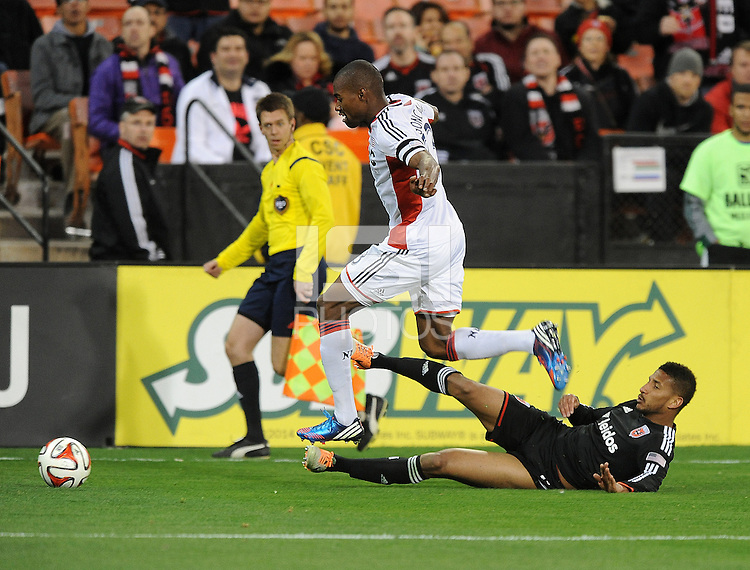 Washington D.C. - April 5, 2014: Jose Goncalves from the New England Revolution goes against Sean Franklin of D.C. United.  D.C. United defeated 2-0 the New England Revolution during a Major League Soccer match for the 2014 season at RFK Stadium.