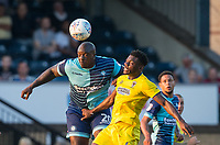 Adebayo Akinfenwa of Wycombe Wanderers beats Deji Oshilaja of AFC Wimbledon in the air during the Friendly match between Wycombe Wanderers and AFC Wimbledon at Adams Park, High Wycombe, England on 25 July 2017. Photo by Andy Rowland.