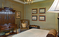 English influenced guest bedroom with unique faux painted walls
