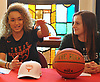 Celeste Taylor, Long Island Lutheran girls basketball standout, left, speaks at the school alongside current teammate and Loyola Maryland commit Emma Glezen after signing a letter of intent to play college basketball at the University of Texas on Wednesday, Nov. 14, 2018.