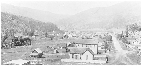 Looking south at Pitkin with C&amp;S coaling trestle to left and depot about a block further south.<br /> C&amp;S  Pitkin, CO  ca. 1900