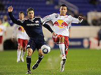 Chris Tierney (8) of the New England Revolution clears the ball away from Connor Chinn (25) of the New York Red Bulls. The New York Red Bulls defeated the New England Revolution 3-0 during a U. S. Open Cup qualifier round match at Red Bull Arena in Harrison, NJ, on May 12, 2010.