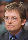 Michael J. Fox testifies during the United States Senate Appropriations Subcommittee on Labor and HHS hearing on Parkinson's Disease in Washington, DC on May 22, 2002. Both Mr. Fox and Mohammad Ali advocated for increased funding to the National Institutes of Health (NIH) for Parkinson's research.<br /> Credit: Ron Sachs / CNP