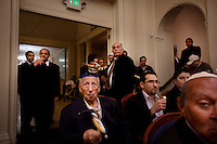 Los Angeles, California, March 19, 2011 - members of the Nessah Synagogue in Beverly Hills make noise with rattles during the reading of the Megillah. The synagogue is home to a predominently Persian congregation. ..Purim is a Jewish holiday that commemorates the deliverance of the Jewish people living in the Persian Empire from genocide at the hands of the political advisor, Haman, to the Persian King Ahasuerus, as documented in the Talmud's Book of Esther. It is celebrated by the reading of the Scroll of Esther or the Megillah, sending food gifts to friends, giving charity to the poor and celebrating with a festive meal. During the reading of the Megillah, when Haman's name is mentioned (which happens 54 times) the congregation engages in loud roars and the use of rattles in an effort to blot out his name. Today children and some adults dress in costume and masquerade to celebrate Purim. The custom is believed to have originated during the 15th century by Italian Jews influenced by the Roman carnival. One idea for the costumes is that God disguised his presence behind many of the natural events that happened during Purim. .