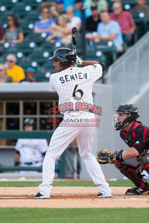 Marcus Semien (6) of the Charlotte Knights at bat against the Rochester Red Wings at BB&T Ballpark on June 5, 2014 in Charlotte, North Carolina.  The Knights defeated the Red Wings 7-6.  (Brian Westerholt/Four Seam Images)