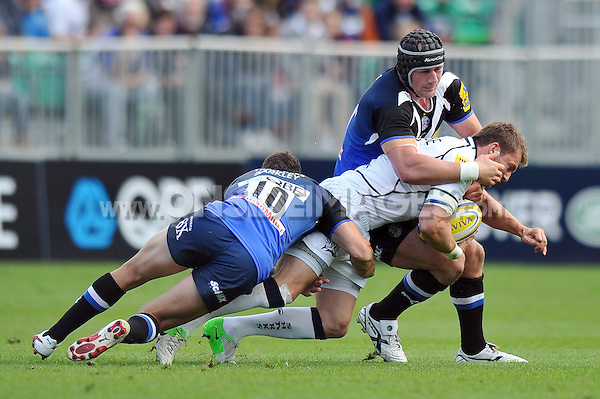 Mark Cueto is double-tackled by Olly Barkley and Carl Fearns. Aviva Premiership match, between Bath Rugby and Sale Sharks on September 29, 2012 at the Recreation Ground in Bath, England. Photo by: Patrick Khachfe / Onside Images