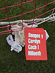 Prestatyn Town 0 Port Talbot Town 0, 19/10/2013. Bastion Gardens, Welsh Premier League. Home team goalkeeper's gloves next to a Welsh language placard with the legend 'Show Racism the Red Card' at Bastion Gardens prior to the match between Prestatyn Town and visitors Port Talbot Town in the Welsh Premier League. Prestatyn Town were Welsh Cup winners in 2013. The match ended goalless and was watched by 211 spectators. Photo by Colin McPherson.
