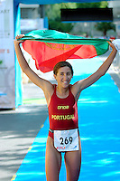 21 JUN 2003 - KARLOVY VARY, CZECH REPUBLIC - Vanessa Fernandes (POR) takes the Junior Womens title at the 2003 European Triathlon Championships. (PHOTO (C) NIGEL FARROW)
