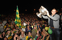 Kerry football captain Darran O'Sullivan  shows off the Sam Maguire Cup to the fans at a welcome home celebration in his home village in Glenbeigh, Co. Kerry on Tuesday night.  Picture: Eamonn Keogh (MacMonagle, Killarney)