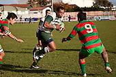 Notise Tauafua is confronted by the charging Nafe Vea.   Counties Manukau Premier Club Rugby game between Wauku & Manurewa played at Waiuku on Saturday June 6th. Manurewa won 36 - 31 after leading 14 - 12 at halftime.