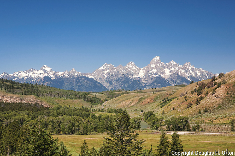 The Teton Range rises over historic Gros Ventre Valley east of Kelly, Wyoming along the road to Slide Lake and the Gros Ventre Slide Overlook.  Off Antelope Flats road and Jackson-Moran Road, Grand Teton National Park.