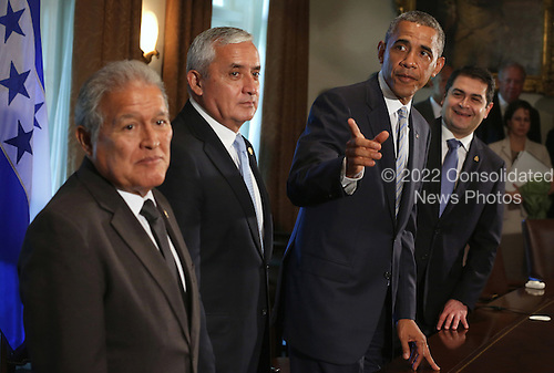 United States President Barack Obama (3rd L) speaks as President Otto Perez Molina (2nd L) of Guatemala, President Juan Orlando Hernandez (R) of Honduras, and President Salvador Sanchez Ceren (L) of El Salvador listen during a meeting in the Cabinet Room of the White House July 25, 2014 in Washington, DC. The leaders met to discuss the current situation of migrant children traveling alone to the U.S. <br /> Credit: Alex Wong / Pool via CNP