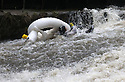 26/12/15<br /> <br /> Even this duck succumbed to getting a good soaking.<br /> <br /> Dozens of competitors are tossed into the Derwent as the extremely swollen river launches rafts, uncontrollably, down a weir along the route of the Boxing Day Race at Matlock Bath in Derbyshire.<br /> <br /> <br /> All Rights Reserved: F Stop Press Ltd. +44(0)1335 418365   www.fstoppress.com.