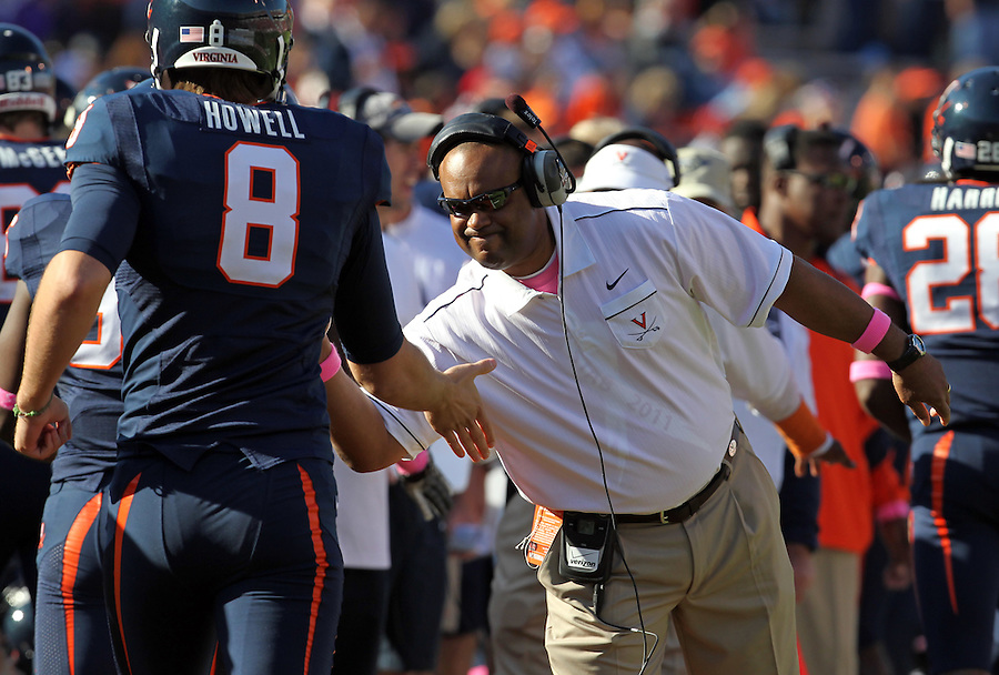 Oct. 22, 2011 - Charlottesville, Virginia - USA; Virginia Cavaliers head coach Mike London congratulates players during an NCAA football game at the Scott Stadium. NC State defeated Virginia 28-14. (Credit Image: © Andrew Shurtleff