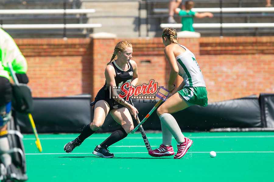 Tyra Clemmenson (12) of the Wake Forest Demon Deacons keeps the ball away from Brittany Hopkins (7) of the William & Mary Tribe during second half action at Kentner Stadium on September 15, 2013 in Winston-Salem, North Carolina.  The Demon Deacons defeated the Tribe 4-0.  (Brian Westerholt/Sports On Film)