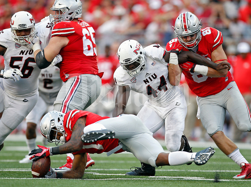 Ohio State Buckeyes wide receiver Braxton Miller (1) fumbles the hand off on a run against Northern Illinois Huskies in the 4th quarter of their game at Ohio Stadium on September 19, 2015.  (Dispatch photo by Kyle Robertson)