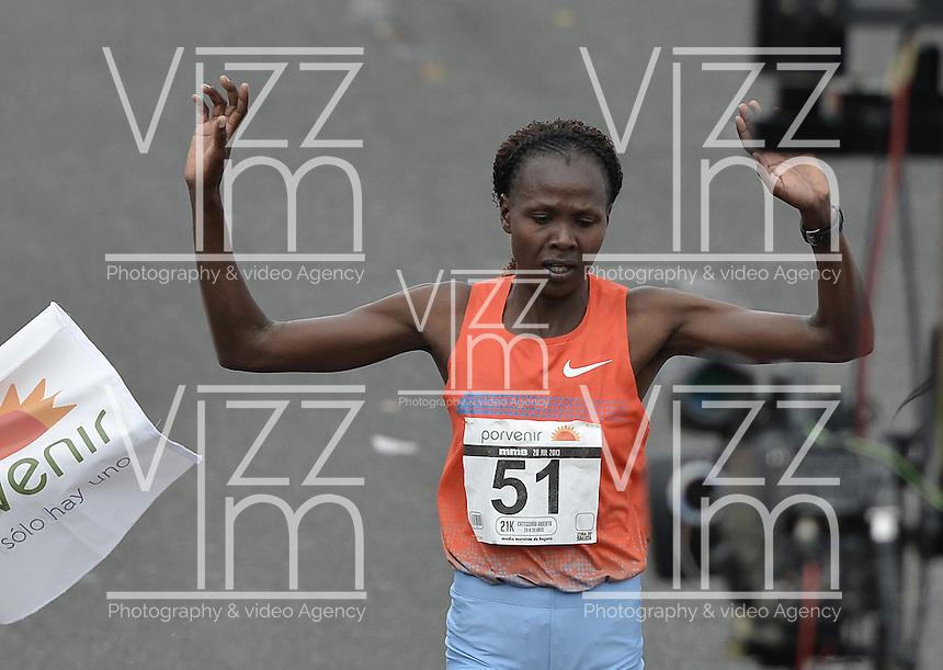 BOGOTÁ -COLOMBIA. 28-07-2013. Priscah Jeptoo (Kenia) con un ntiempo de 1.12:24 fue  la ganadora de la Media Maratón de Bogotá 2013 en categoría mujeres. En esta ocasión Geoffrey Kipsang (Kenia) fue el ganador en varones con un tiempo de 1.03:46. / Priscah Jeptoo (Kenya) with a time of 1.12:24 was the winner of the Half Marathon of Bogota 2013 in women category. In this edition Geoffrey Kipsang (Kenya) with a time of 1.03:46 and in women the winner  was . Photo: VizzorImage / Str