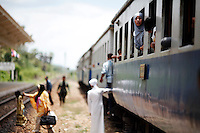 Thai Muslim passengers board the train protected by armed security personnel between troubled Yala and Pattani provinces in southern Thailand March 30, 2010. Separatists are blamed for most of the attacks on Thailand's predominantly Muslim deep south, which often target Buddhists and Muslims associated with the Thai state, such as police, soldiers, government officials and teachers. No credible group has claimed responsibility for near daily drive-by shootings and bombings, which continue unabated, despite a massive counterinsurgency effort. The government has sought to tackle the unrest with a five-year $1.9 billion stimulus to reduce economic disparity and minimise the influence of insurgents, but many locals believe the measures will be futile. REUTERS/Damir Sagolj (THAILAND)