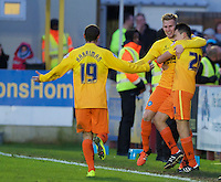 Jason McCarthy of Wycombe Wanderers (middle) celebrates scoring the opening goal with Luke O'Nien of Wycombe Wanderers (right) and Michael Harriman of Wycombe Wanderers during the Sky Bet League 2 match between AFC Wimbledon and Wycombe Wanderers at the Cherry Red Records Stadium, Kingston, England on 21 November 2015. Photo by Alan  Stanford/PRiME.