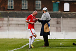Ragnar the Viking, Yorkshire's mascot consoles Jersey's Luke Watson at full time. Yorkshire v Parishes of Jersey, CONIFA Heritage Cup, Ingfield Stadium, Ossett. Yorkshire's first competitive game. The Yorkshire International Football Association was formed in 2017 and accepted by CONIFA in 2018. Their first competative fixture saw them host Parishes of Jersey in the Heritage Cup at Ingfield stadium in Ossett. Yorkshire won 1-0 with a 93 minute goal in front of 521 people. Photo by Paul Thompson