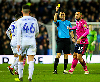 Referee Peter Bankes shows Queens Park Rangers' Joel Lynch a yellow card<br /> <br /> Photographer Alex Dodd/CameraSport<br /> <br /> The EFL Sky Bet Championship - Leeds United v Queens Park Rangers - Saturday 8th December 2018 - Elland Road - Leeds<br /> <br /> World Copyright &copy; 2018 CameraSport. All rights reserved. 43 Linden Ave. Countesthorpe. Leicester. England. LE8 5PG - Tel: +44 (0) 116 277 4147 - admin@camerasport.com - www.camerasport.com