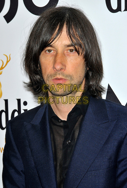 Bobby Gillespie - Primal Scream.Mojo Honours List 2011 Awards Ceremony, held at The Brewery - Arrivals London, England..July 21st, 2011.headshot portrait blue black stubble facial hair.CAP/CJ.©Chris Joseph/Capital Pictures.