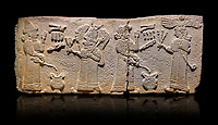 Aslantepe Monumental Hittite relief sculpted orthostat stone panel.  Limestone, Aslantepe, Malatya, 1200-700 B.C. <br /> <br /> <br /> Scene of the king's offering drink and sacrifice to the gods. The king offers to the winged god of the moon who stands across and holds a lightning bundle in his hand. Behind the king is the queen, who also offers to goddess of the sun holding a sceptre in his hand. King's left hand is in a position to worship. <br /> <br /> Against a black background.
