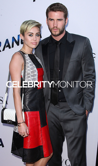 "[(FILE) Miley Cyrus and Liam Hemsworth call off engagement - announced Monday, September 16, 2013.] LOS ANGELES, CA - AUGUST 08: Miley Cyrus and Liam Hemsworth arrive at the ""Paranoia"" Los Angeles Premiere held at DGA Theater on August 8, 2013 in Los Angeles, California. (Photo by Xavier Collin/Celebrity Monitor)"