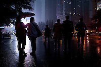 People Standing In The Road In The Rain In Chongqing, China.  © LAN