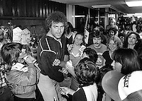 Oakland Raider lineman John Matuszak mobbed by fans at the airport returning from playoff win in Cleveland. (Jan 4,1981 photo by Ron Riesterer)