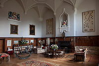 The vaulted hall is decorated with extensive family trees and heraldry