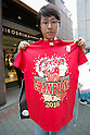 A Hiroshima Carp baseball team fan shows a Central League Champions 2016 t-shirt after bought it at Hiroshima Brand Shop TAU in Ginza on September 11, 2016, Tokyo, Japan. Hundreds of Carps fans lined up from early morning outside Hiroshima Brand Shop TAU to buy victory t-shirts after Hiroshima baseball team got its first Central League title in 25 years after beating the Yomiuri Giants 6-4 on Saturday, September 10. (Photo by Rodrigo Reyes Marin/AFLO)