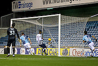 Garry Thompson of Wycombe Wanderers taps home the third goal during the Checkatrade Trophy round two Southern Section match between Millwall and Wycombe Wanderers at The Den, London, England on the 7th December 2016. Photo by Liam McAvoy.