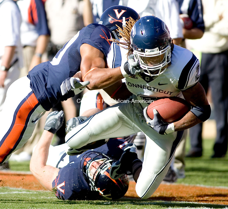 CHARLOTTESVILLE, VA- 13 OCT 2007- 101307JT14- <br /> UConn's Andre Dixon gets tackled by Virginia's Nate Lyles and Jon Copper during the first quarter of Saturday's game at Virginia. UConn lost 16-17.<br /> Josalee Thrift / Republican-American