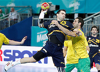 Spain's Carlos Ruesga Pasarin (l) and Australia's Ognjen Matic during 23rd Men's Handball World Championship preliminary round match.January 15,2013. (ALTERPHOTOS/Acero) /NortePhoto