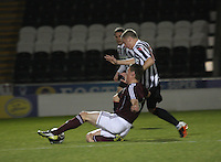 Callum Tapping beats Declan Hughes to the ball in the St Mirren v Heart of Midlothian Clydesdale Bank Scottish Premier League U20 match played at St Mirren Park, Paisley on 6.11.12.