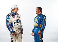Feb 6, 2019; Pomona, CA, USA; NHRA funny car drivers John Force (left) and Ron Capps talk during NHRA Media Day at the NHRA Museum. Mandatory Credit: Mark J. Rebilas-USA TODAY Sports