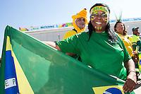 A Brazil fan outside the Stadium Arena Corinthians