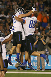 Boise State's Jake Roh (88) celebrates with teammates Thomas Sperbeck (82) and Devan Demas (26) after scoring against Nevada during the first half of an NCAA college football game in Reno, Nev, on Saturday, Oct. 4, 2014. (AP Photo/Cathleen Allison)