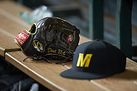 A Rawlings glove sits on the bench near a Missouri Tigers cap during the game against the Texas Longhorns in game eight of the 2020 Shriners Hospitals for Children College Classic at Minute Maid Park on March 1, 2020 in Houston, Texas. The Tigers defeated the Longhorns 9-8. (Brian Westerholt/Four Seam Images)