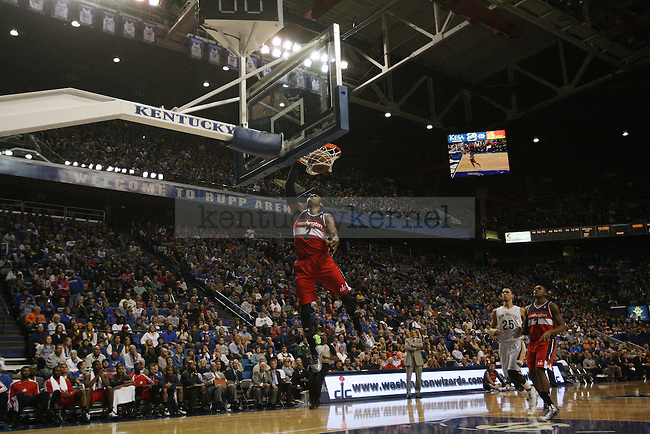 Former UK guard John Wall dunks during a NBA Preseason game between the Washington Wizards and the New Orleans Pelicans at Rupp Arena in Lexington, Ky., on Saturday, October 19, 2013. Photo by Michael Reaves | Staff