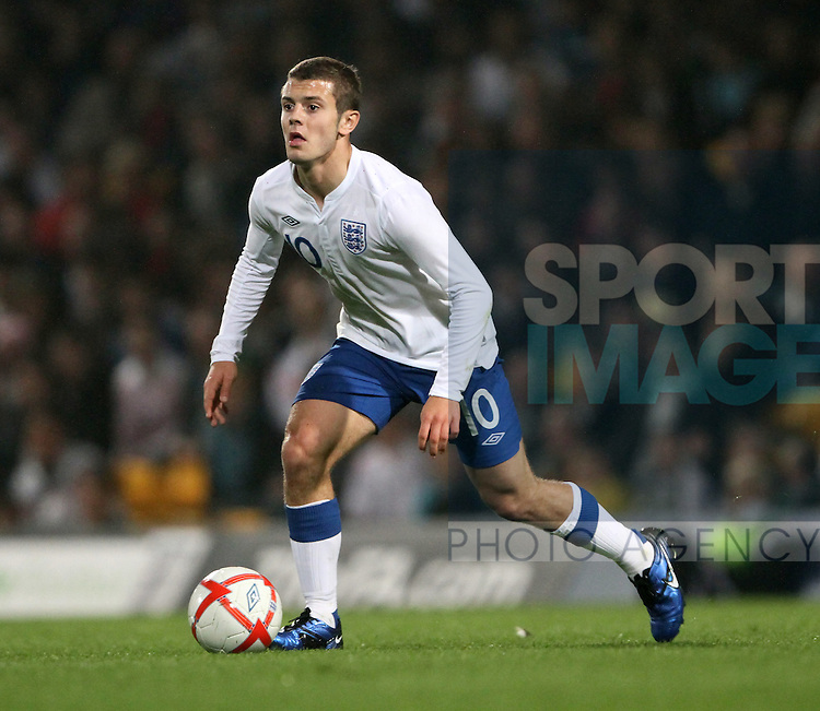 Englands Jack Wilshere in action