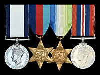 BNPS.co.uk (01202 558833)<br /> Pic:  DixNoonanWebb/BNPS<br /> <br /> The gallantry medals awarded to one of the heroes of a daring raid on the Tirpitz who later escaped a Nazi death march have emerged for sale for &pound;50,000.<br /> <br /> Engine Room Artificer 4th Class Edmund Goddard was the helmsman of the midget submarine X6 which attacked the heavily protected battleship while it was docked in the Norwegian fjords.<br /> <br /> They sneaked under the giant 820ft vessel and set off four depth charges, with the force of the explosion putting the 43,000 tonne Tirpitz 7ft out of action for six months.<br /> <br /> Goddard, one of just six survivors from the raid, was captured and sent to a POW camp in Germany. He was later awarded the prestigious Conspicuous Gallantry Medal.