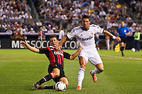 Daniele Bonera (25) of A. C. Milan goes for a tackle on Cristiano Ronaldo (7) of Real Madrid. Real Madrid defeated A. C. Milan 5-1 during a 2012 Herbalife World Football Challenge match at Yankee Stadium in New York, NY, on August 8, 2012.