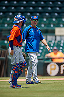 St. Lucie Mets pitching coach Mike Cather (25) talks with catcher Jake Ortega on the way to the mound during a Florida State League game against the Bradenton Marauders on July 28, 2019 at LECOM Park in Bradenton, Florida.  Bradenton defeated St. Lucie 7-3.  (Mike Janes/Four Seam Images)